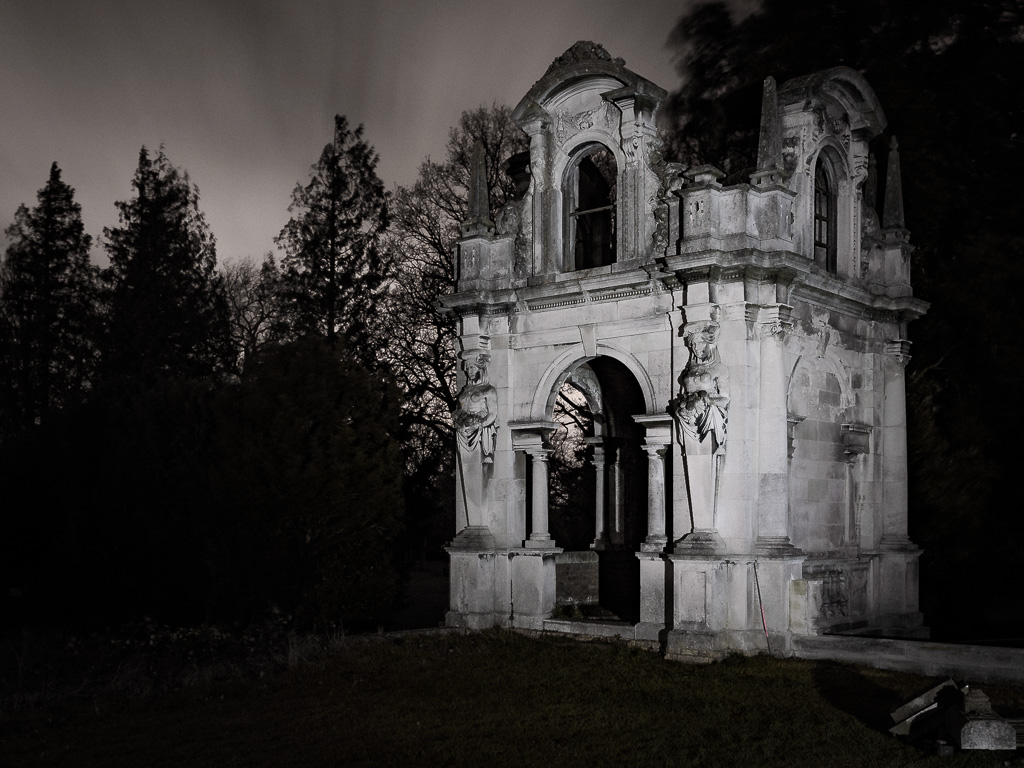 Picture of a stone folly in the grounds of Copped Hall taken at night with a long exposure and cool torchlight used to paint the details